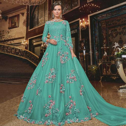 Appealing Aqua Blue Colored Partywear Embroidered Soft Net Anarkali Suit
