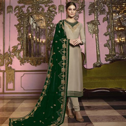 Capricious Beige Colored Partywear Embroidered Georgette Suit