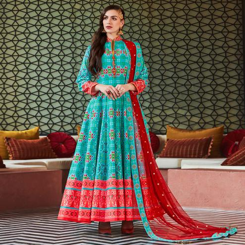 Ravishing Aqua Blue Colored Partywear Embroidered Silk Anarkali Suit