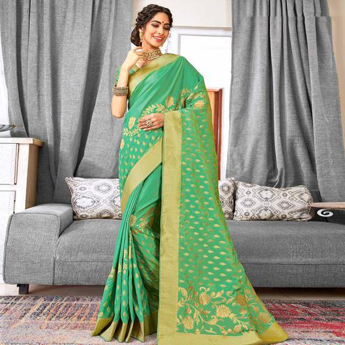 Groovy Turquoise Green Colored Festive Wear Woven Silk Saree