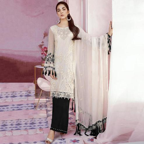 Exotic White-Black Colored Party Wear Embroidered Georgette Palazzo Suit