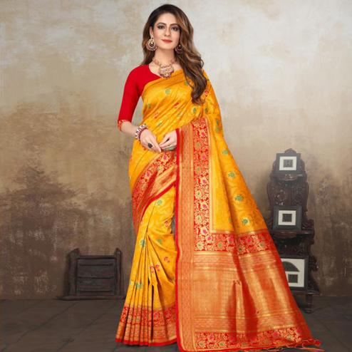Adorable Yellow Colored Festive Wear Woven Raw Silk Saree With Tassels