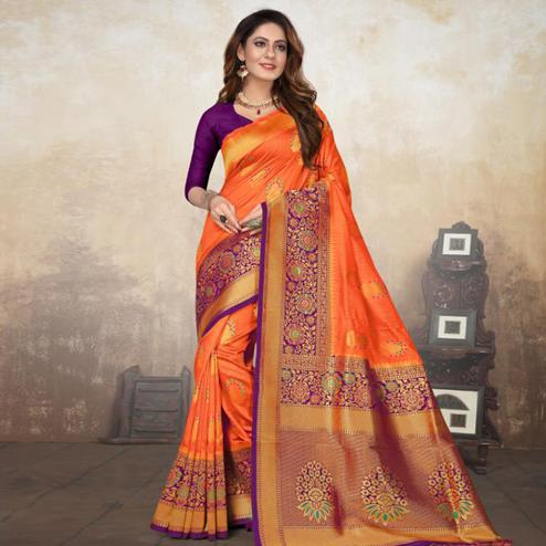 Attractive Orange Colored Festive Wear Woven Raw Silk Saree With Tassels