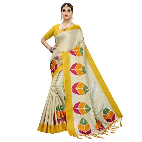 Lovely Beige-Yellow Colored Festive Wear Leaf Printed Art Silk Saree With Tassel