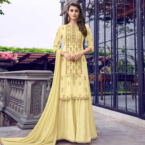 Intricate Yellow Colored Party Wear Embroidered Cotton  Suit With Jacket