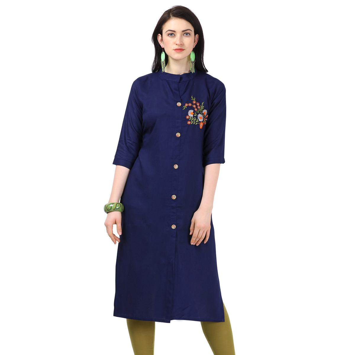 Engrossing Navy Blue Colored Partywear Embroidered Rayon Kurti