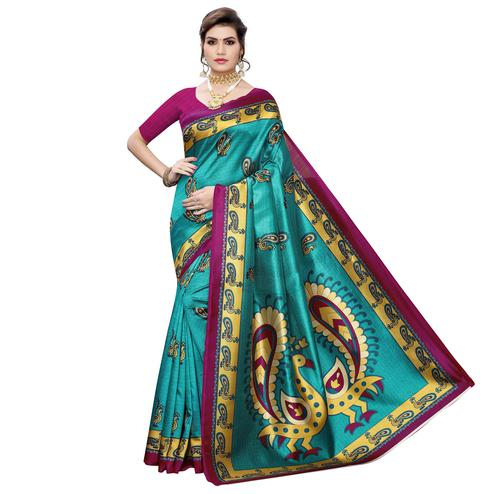 Beautiful Turquoise Green Colored Casual Wear Peacock Printed Art Silk Saree