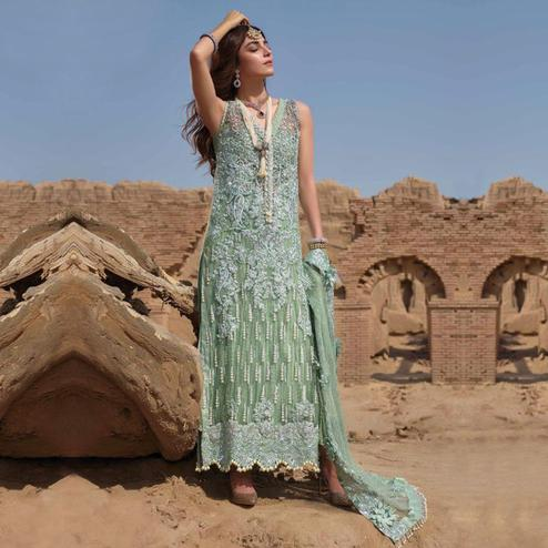 Mesmeric Mint Green Colored Party Wear Embroidered Net Palazzo Suit