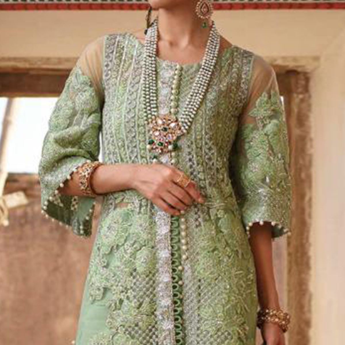 Hypnotic Mint Green Colored Party Wear Embroidered Net Palazzo Suit