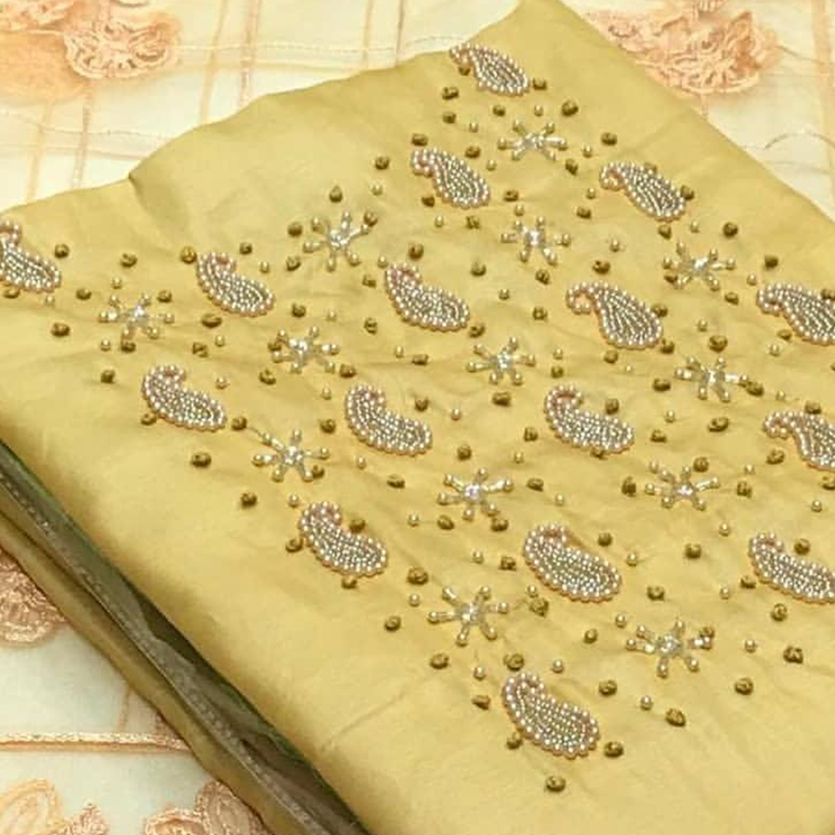 Elegant Yellow Colored Party Wear Embroidered Modal Dress Material