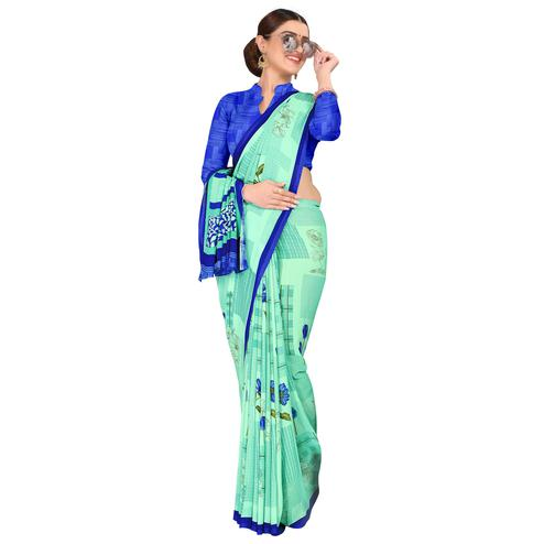 Intricate Aqua Green Colored Casual Wear Printed Georgette Saree