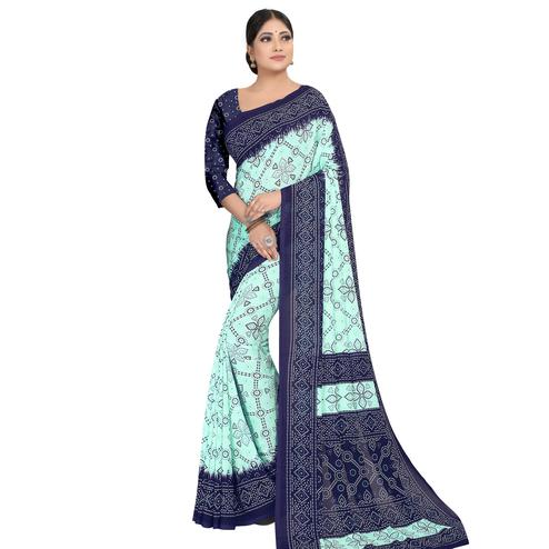 Gleaming Aqua Blue Colored Casual Wear Printed Georgette Saree
