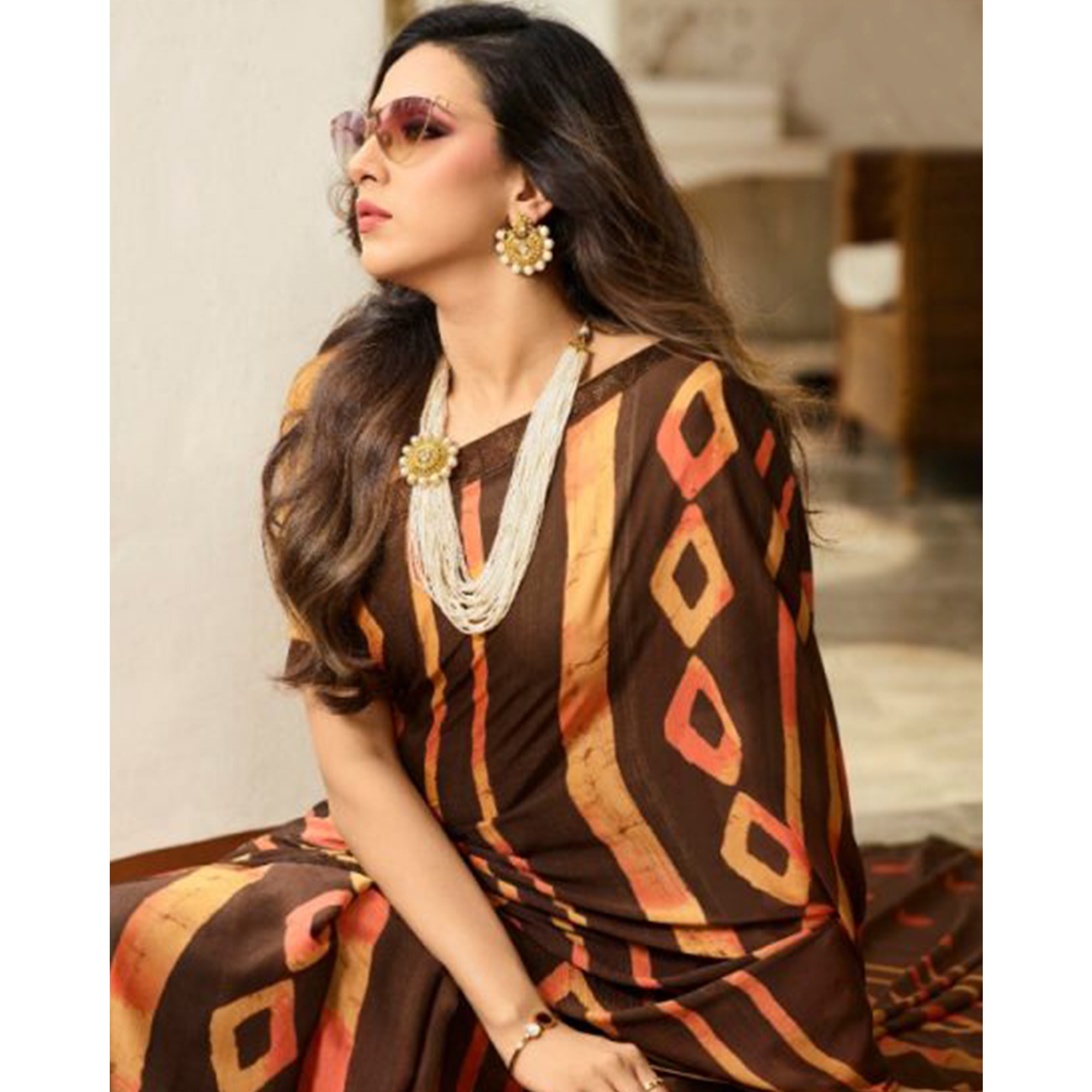 Attractive Brown Colored Casual Wear Printed Georgette Saree