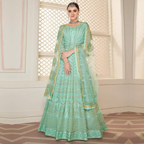 Alluring Aqua Green Colored Partywear Lakhanavi Embroidered Georgette Anarkali Suit