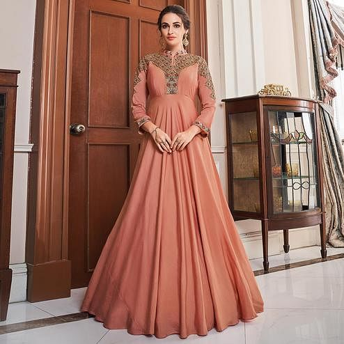 Magnetic Peach Colored Partywear Embroidered Tapetta Silk Gown