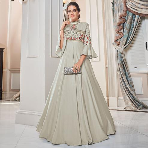 Excellent Light Grey Colored Partywear Embroidered Tapetta Silk Gown