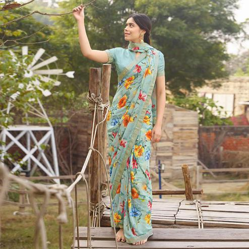 Hypnotic Light Blue Colored Casual Floral Printed Georgette Saree