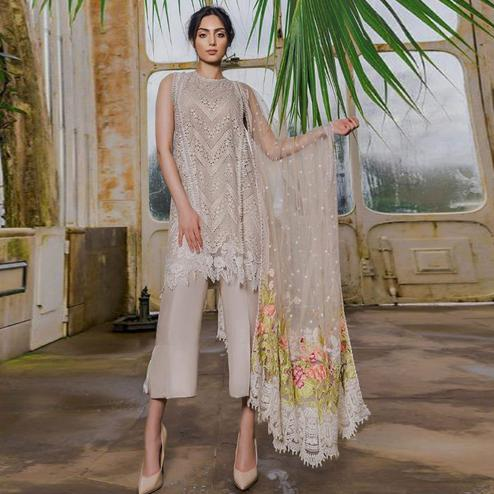 Magnetic Beige Colored Partywear Chikankari Embroidered Cotton Palazzo Suit