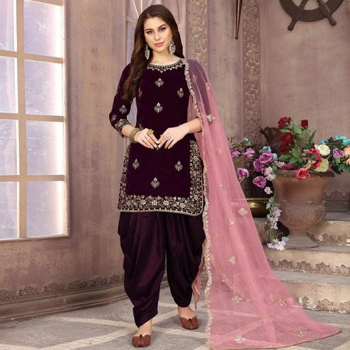 Pleasant Wine Colored Partywear Embroidered Velvet Patiala Suit