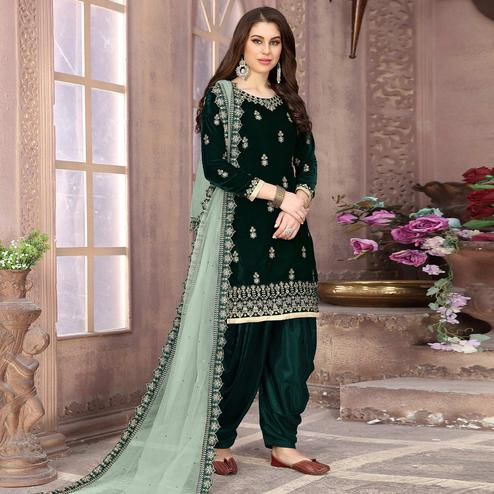 Opulent Bottle Green Colored Partywear Embroidered Velvet Patiala Suit