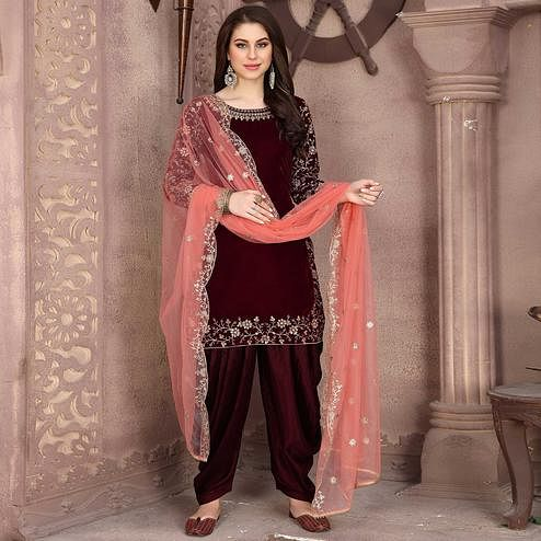 Glowing Maroon Colored Partywear Embroidered Velvet Patiala Suit