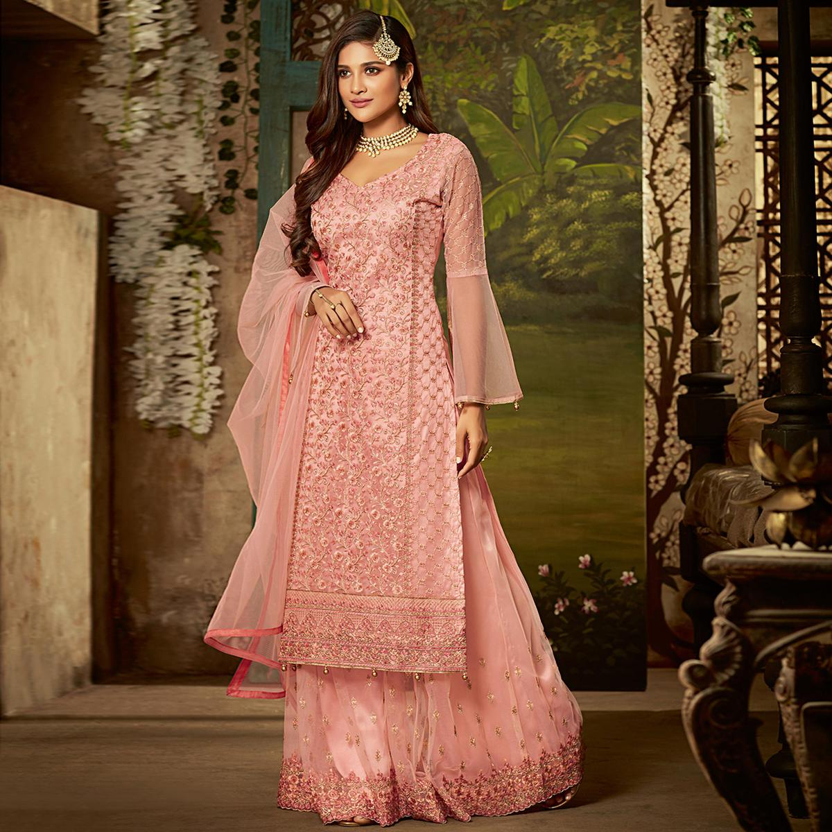Entrancing Pink Colored Partywear Embroidered Netted Palazzo Suit