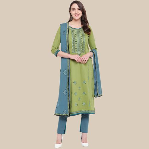 Opulent Olive Green Colored Partywear Embroidered Cotton Dress Material