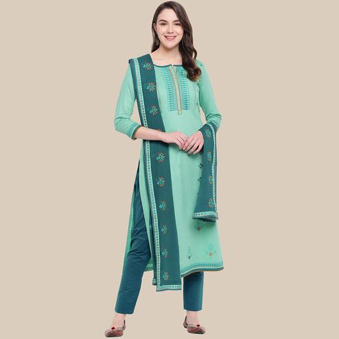 Gleaming Aqua Green Colored Partywear Embroidered Cotton Dress Material