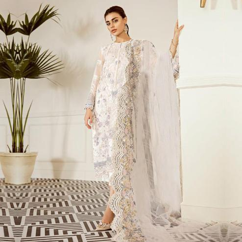 Delightful White Colored Partywear Embroidered Netted Suit