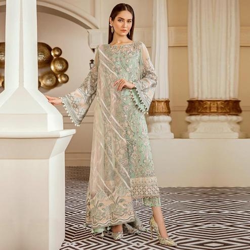 Engrossing Mint Green Colored Partywear Embroidered Netted Suit