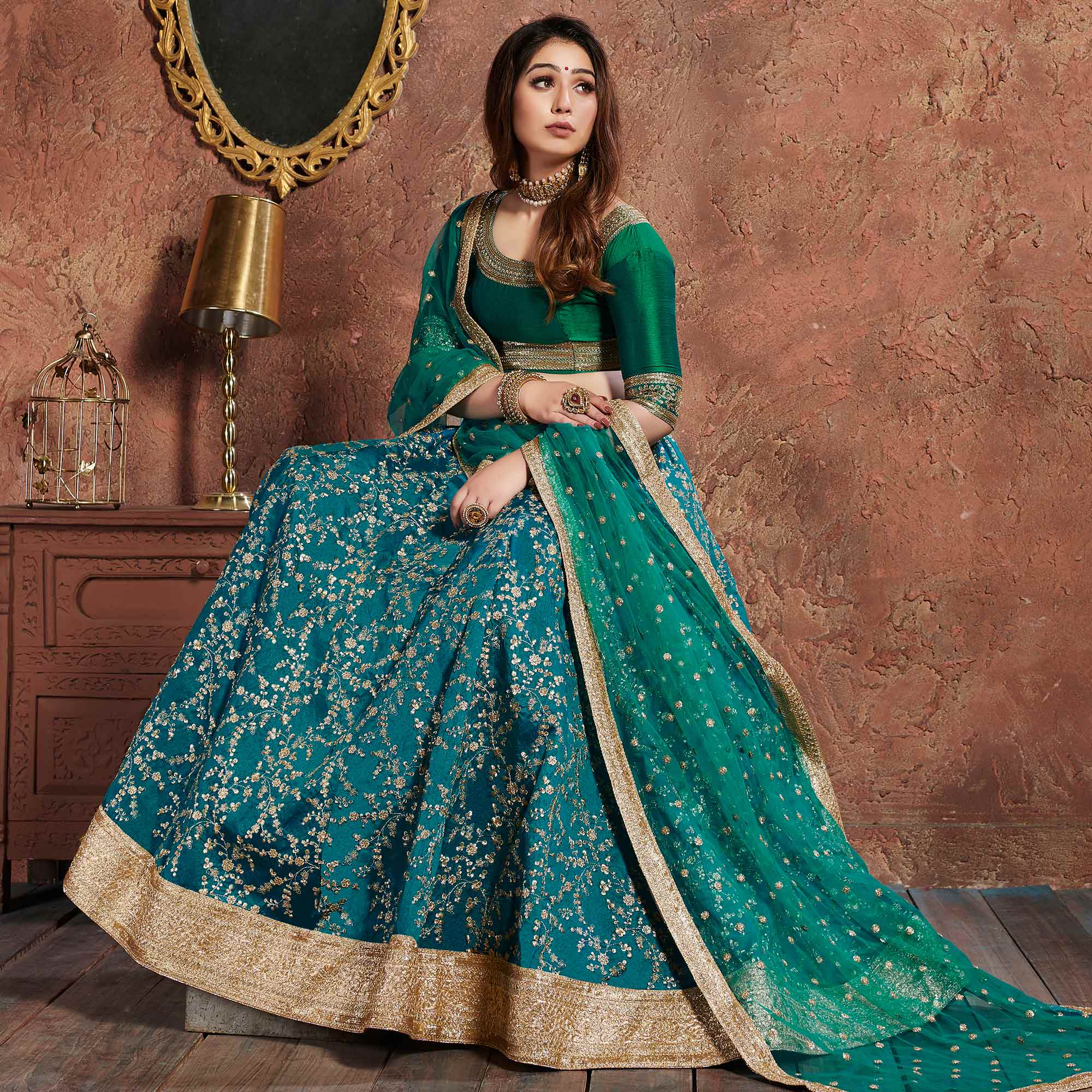 Exclusive Turquoise Green Colored Wedding Wear Embroidered Art Silk Lehenga Choli