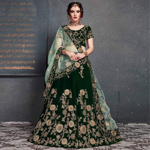Exceptional Dark Green Colored Wedding Wear Embroidered Velvet Lehenga Choli