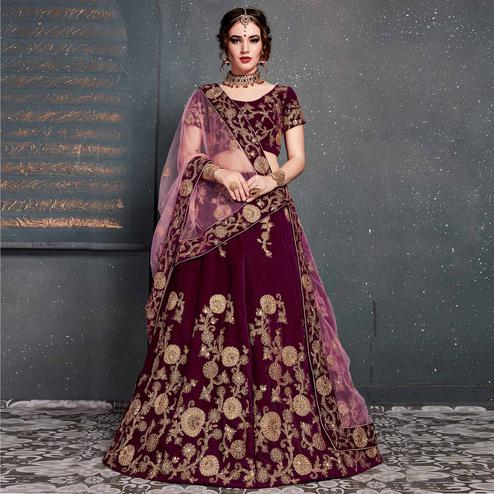 Eye-catching Purple Colored Wedding Wear Embroidered Velvet Lehenga Choli