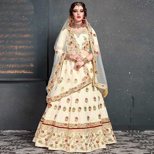 Magnetic Cream Colored Wedding Wear Embroidered Silk Lehenga Choli