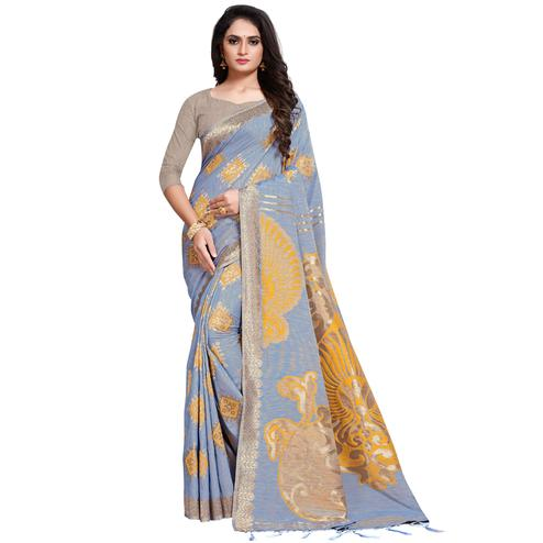 Adorning Stone Blue Colored Festive Wear Woven Silk Blend Saree With Tassles
