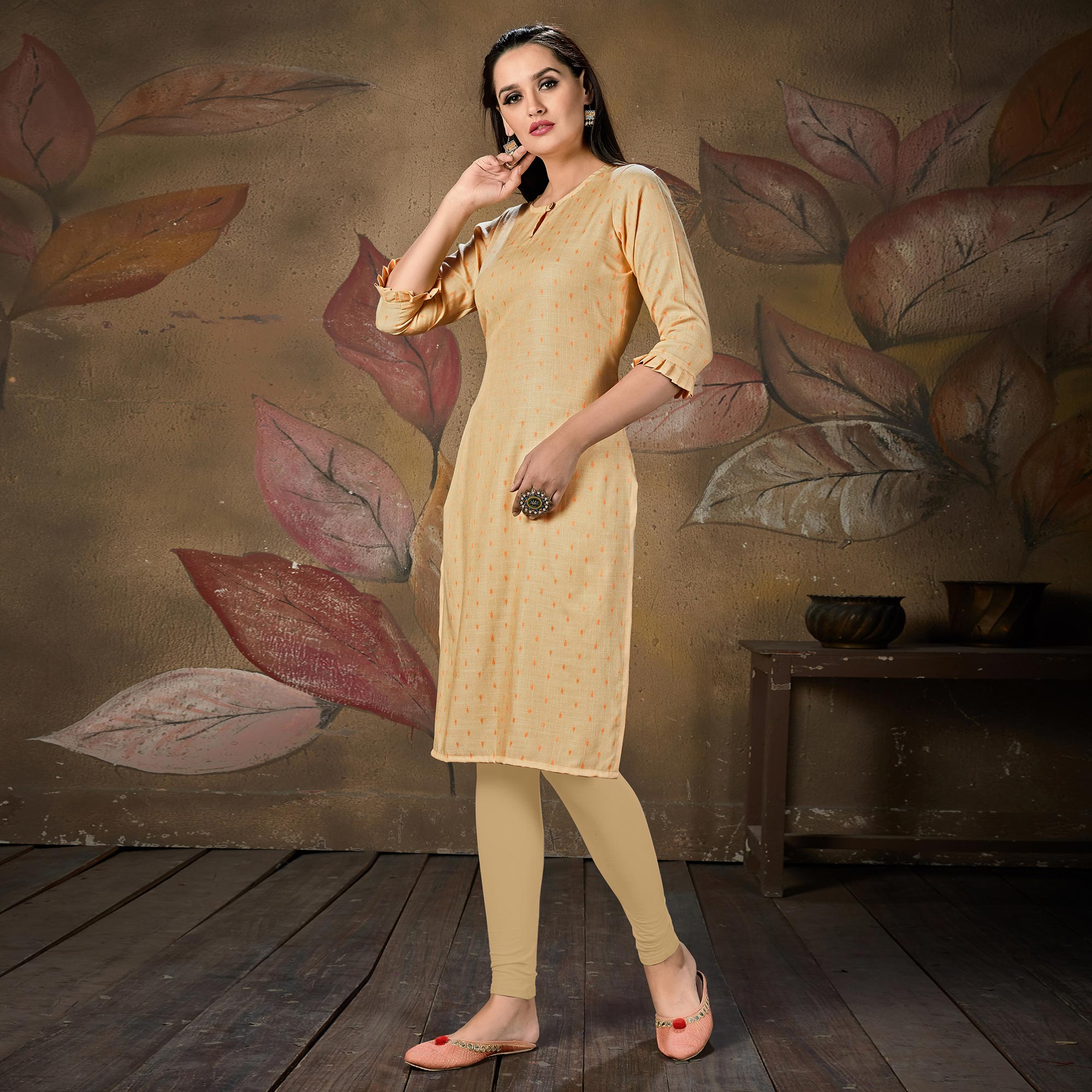 Gleaming Light Peach Colored Casual Embroidered Cotton Kurti
