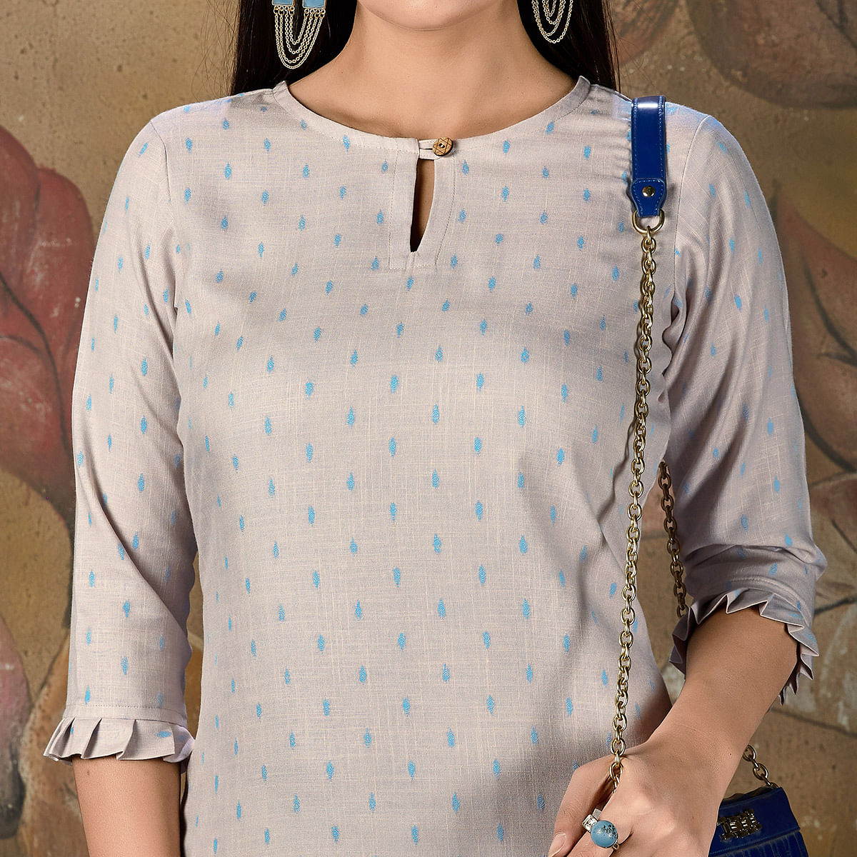 Mesmeric Light Blue Colored Casual Embroidered Cotton Kurti