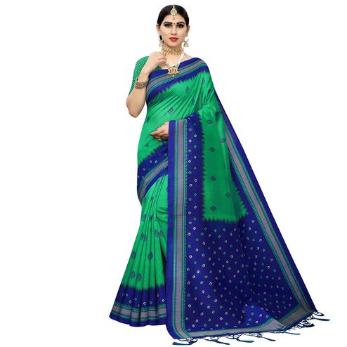 Eye-catching Green Colored Casual Printed Art Silk Saree With Tassels