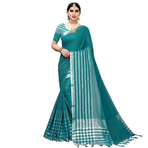 Impressive Rama Green Colored Casual Printed Cotton Silk Saree With Tassels