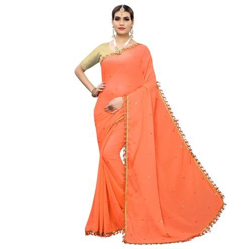 Captivating Orange Colored Party Wear Embroidered Georgette Saree With Tassels