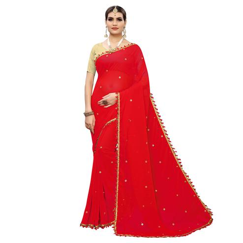 Innovative Red Colored Party Wear Embroidered Georgette Saree With Tassels