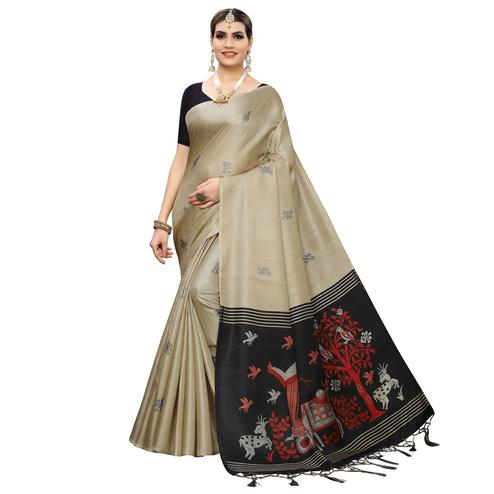 Glorious Chiku Colored Casual Wear Printed Cotton Silk Saree With Tassles