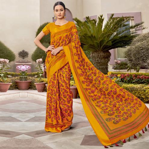 Attractive Mustard Colored Casual Wear Printed Cotton Saree With Tassels