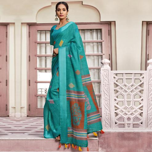 Graceful Rama Green Colored Casual Wear Printed Cotton Saree With Tassels