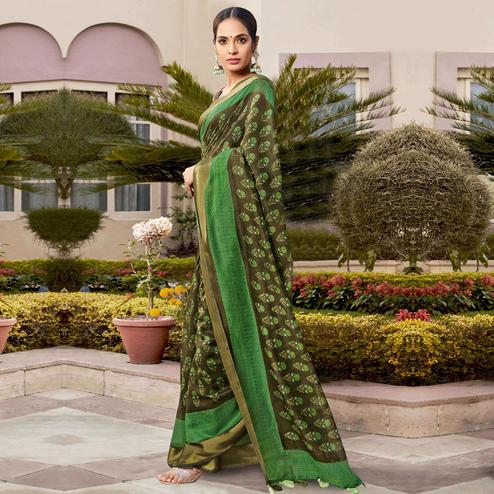 Blooming Mehandi Green Colored Casual Wear Printed Cotton Saree With Tassels