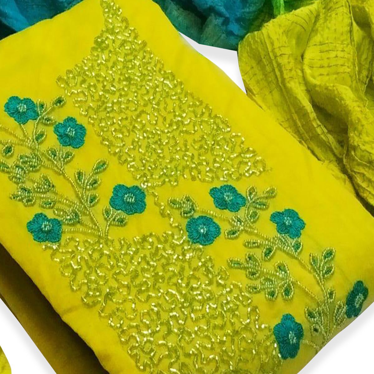 Adorable Light Green Colored Partywear Embroidered Cotton Dress Material