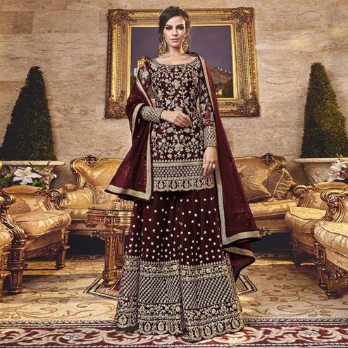Imposing Maroon Colored Party Wear Embroidered Net Sharara Suit