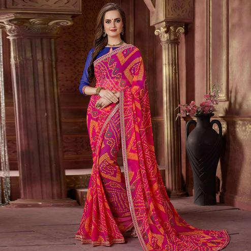 Intricate Pink Colored Casual Wear Bandhani Printed Georgette Saree