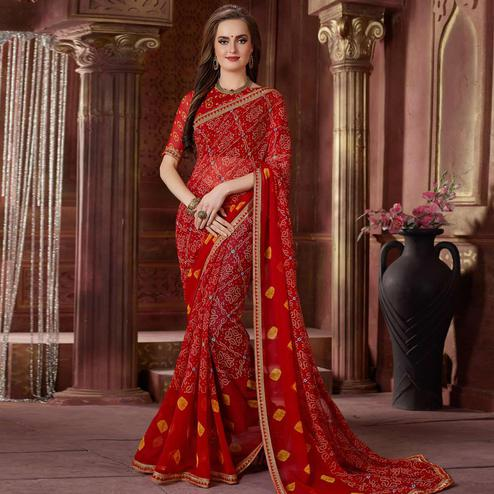 Opulent Red Colored Casual Wear Bandhani Printed Georgette Saree