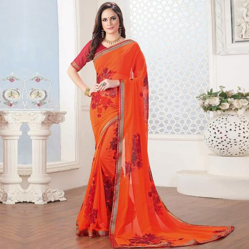 Intricate Orange Colored Casual Floral Printed Georgette Saree